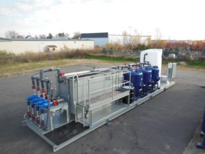 Mobile rental water treatment skid, oil/water separator, sand filters
